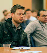 Jeremy Mann, MDiv student, listens to Rev. Isaac Smith