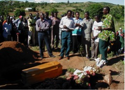 We often went to funerals of children of friends in Tanzania. Here the 4-year-old son of a pastor, one of our Bible school students, is being buried. The hospital said the child died from sickle cell anemia, but relatives at the funeral blamed his father for causing the death by failing to consult the ancestors through the local healer to discover the real cause of the death. Virtually all of our students who had children had buried a child.