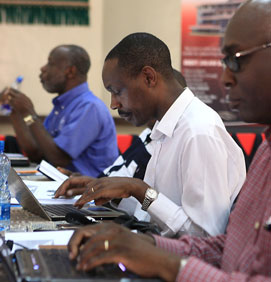 David K. Ngaruiya, International Leadership University, takes notes during a session.